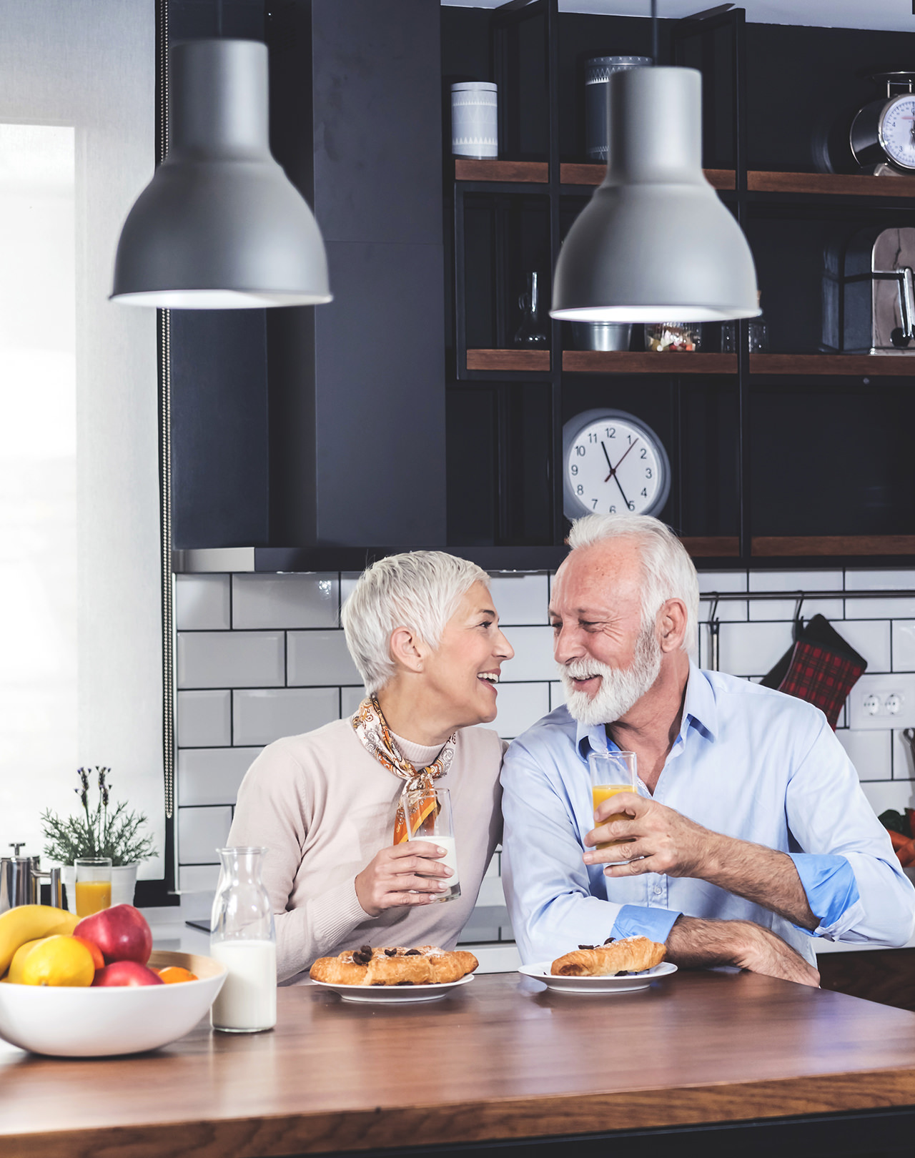 Castlepoint Wealth Advisors clients - retired couple sitting in kitchen living abundantly